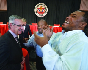 Tressel sharing a laugh with university community.