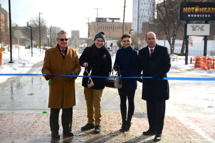 Cutting the ribbon at the reopening of Lincoln Ave.