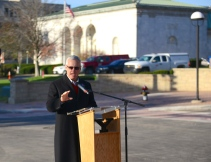 Tressel speaking at the Wick Ave. ribbon cutting ceremony.