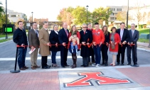 Cutting the ribbon at the reopening of Wick Ave.